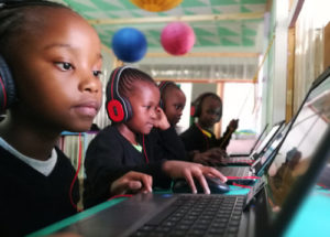 Streetlight Schools learners busy at their laptops